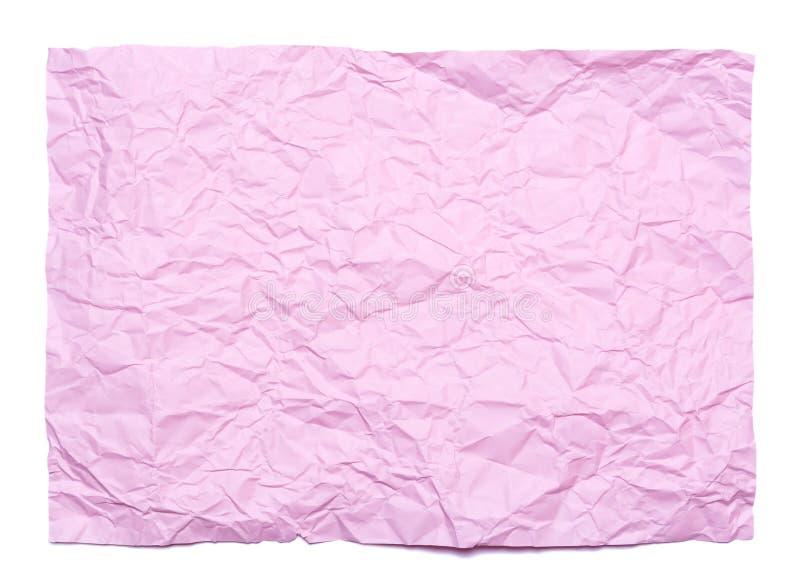 Bakgrund av det rosa färger skrynkliga arket av papper royaltyfria foton