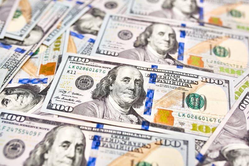 Bakgrund av 100 dollarräkningar Pengaramerikan hundra dollarbi arkivfoto