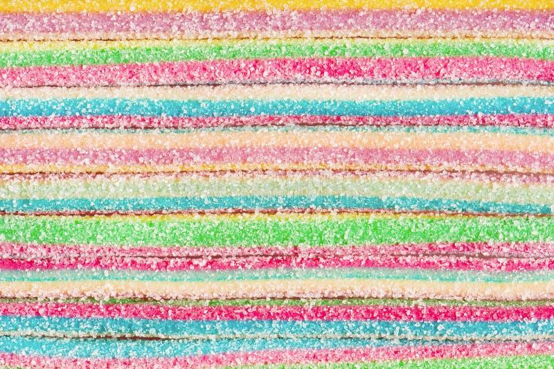 Bakgrund av flerfärgade godisband arkivbilder