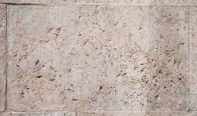 Bakgrund av fragmentet av den gamla romaren stenar väggen arkivfoto