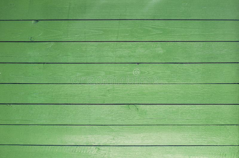 Bakgrund av gamla målade gröna bräden arkivbilder
