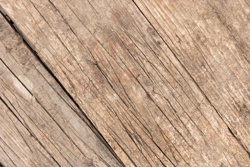 Bakgrund av gamla skrapade plankabräden som tätt tillsammans knackas royaltyfri fotografi
