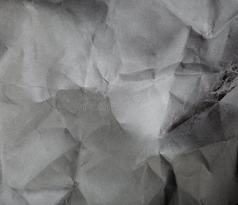 Bakgrund av gammalt skrynkligt papper arkivbild