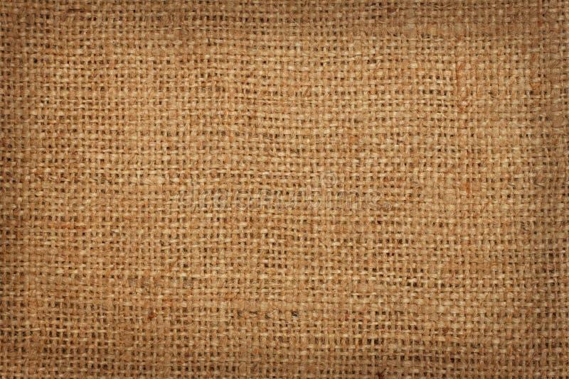 Bakgrund av grov linneburlap arkivfoto