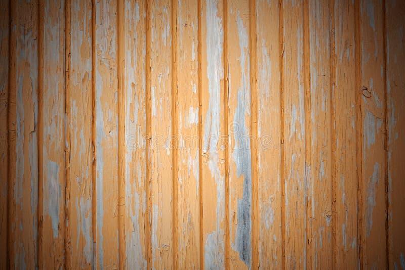 Bakgrund av guling målade bräden arkivfoto