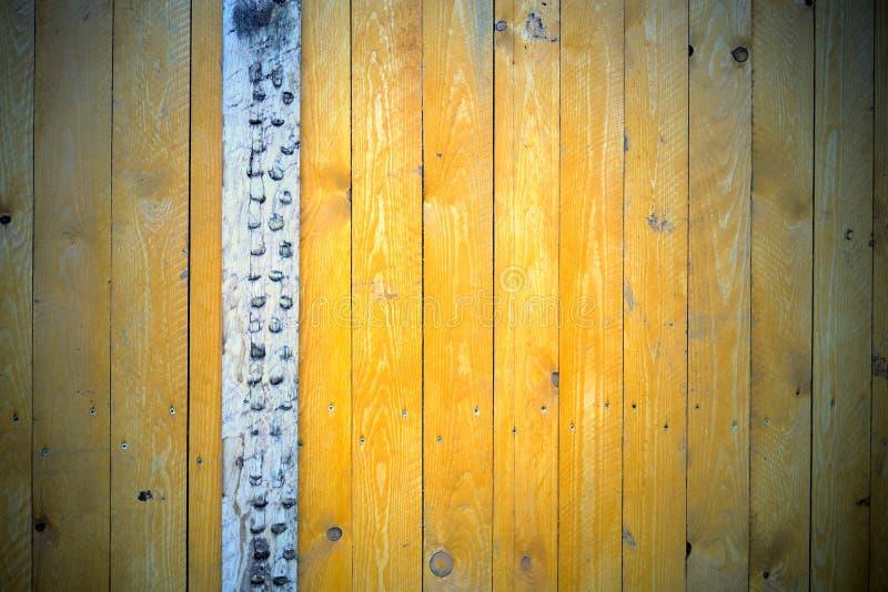 Bakgrund av guling målade bräden royaltyfria foton