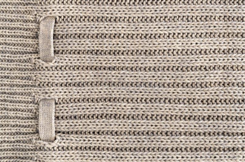 Bakgrund av handgjort stuckit tyg av ullkrämfärg, torkduk stack textur royaltyfri bild