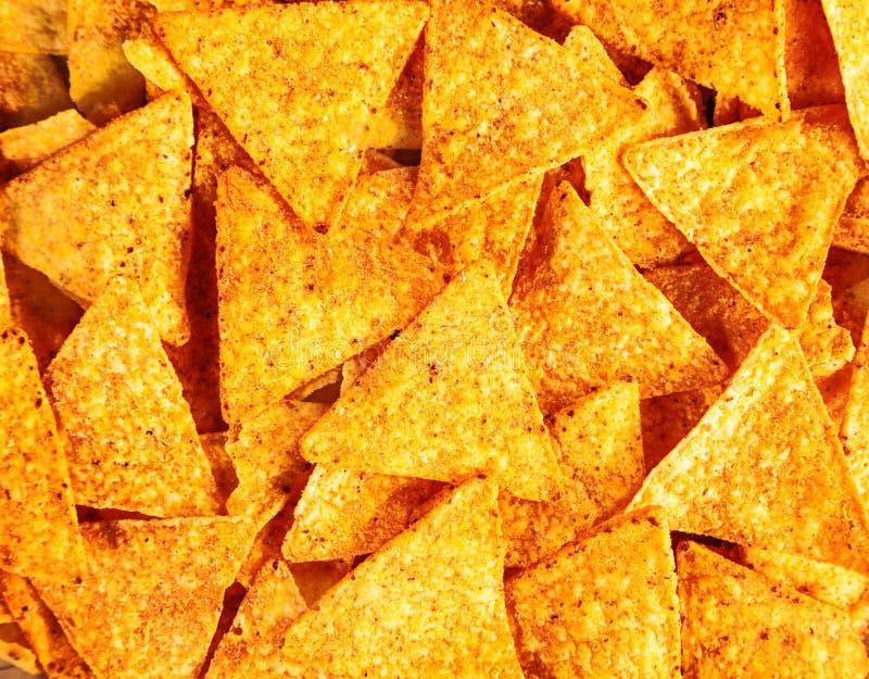 Bakgrund av havretortillor eller nachos arkivfoton