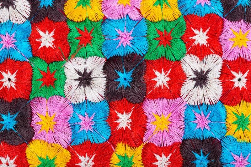 Färgrika blommor, broderi arkivfoton