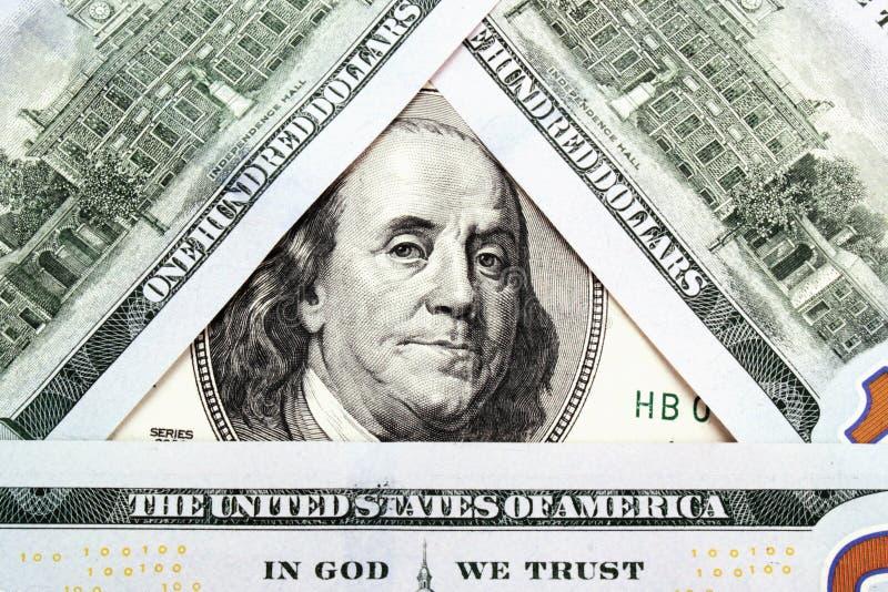 Bakgrund av pengarslutet upp av dollarräkningen arkivbild