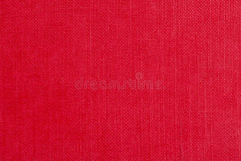 Bakgrund av rött linnetyg, ställe för text arkivfoton