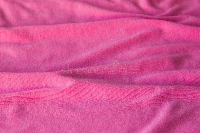 Bakgrund av rosa tyg Kan användas som bakgrund, tapet royaltyfria bilder