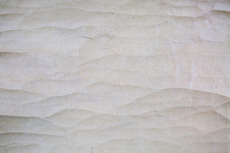 Bakgrund av skrynkliga pappgrå färger arkivbild