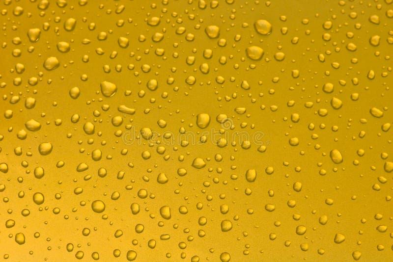 Bakgrund av vattendroppar på yttersida arkivfoton
