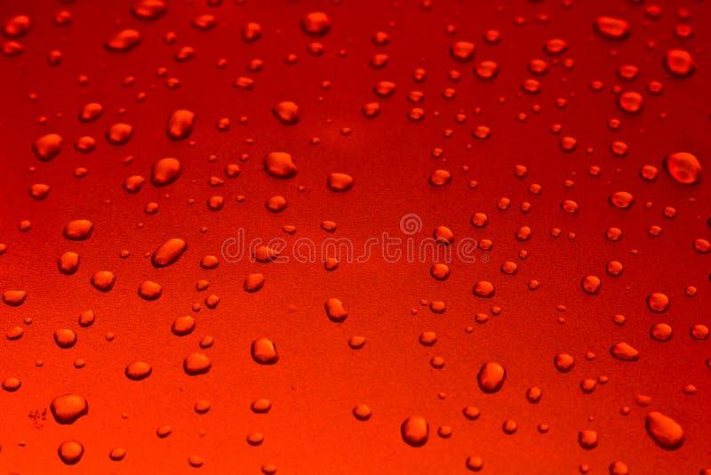 Bakgrund av vattendroppar på yttersida arkivfoto