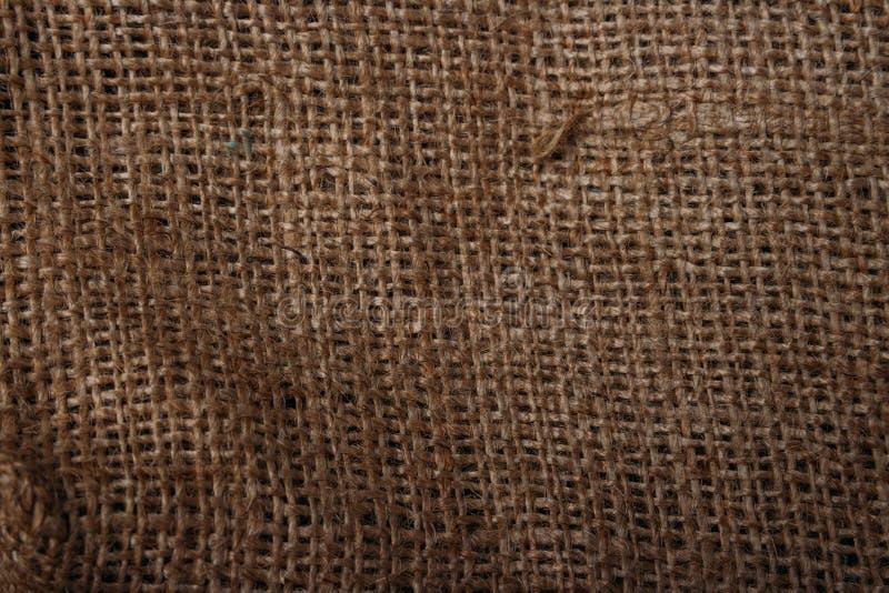 bakgrund boards horisontalknotty sörjer textur Bakgrund av den naturliga bruna torkduken göra mörkare av kanterna Sackcloth textu arkivbilder