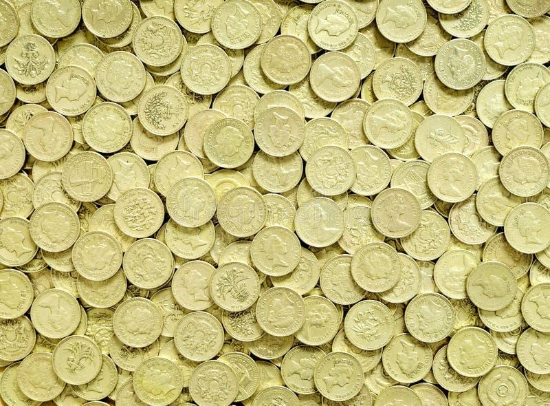 bakgrund coins pundet royaltyfri bild