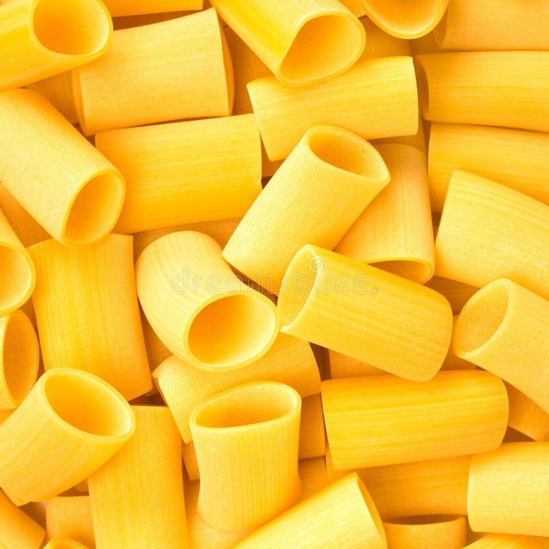 Bakgrund eller textur för råkost för pasta för italienarePaccheri makaroni royaltyfri foto