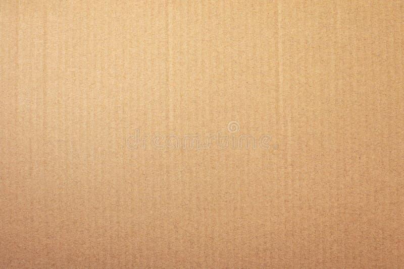 Bakgrund för brun pappers- textur eller papp Yttersida av återanvänt pappers- material arkivbilder
