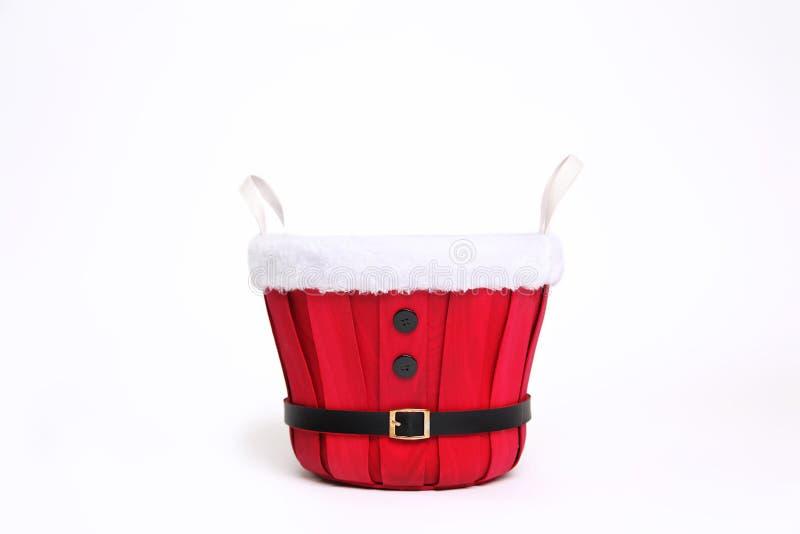 Bakgrund för Digitalt fotografi av röd Santa Christmas Bucket Isolated On vit arkivfoto