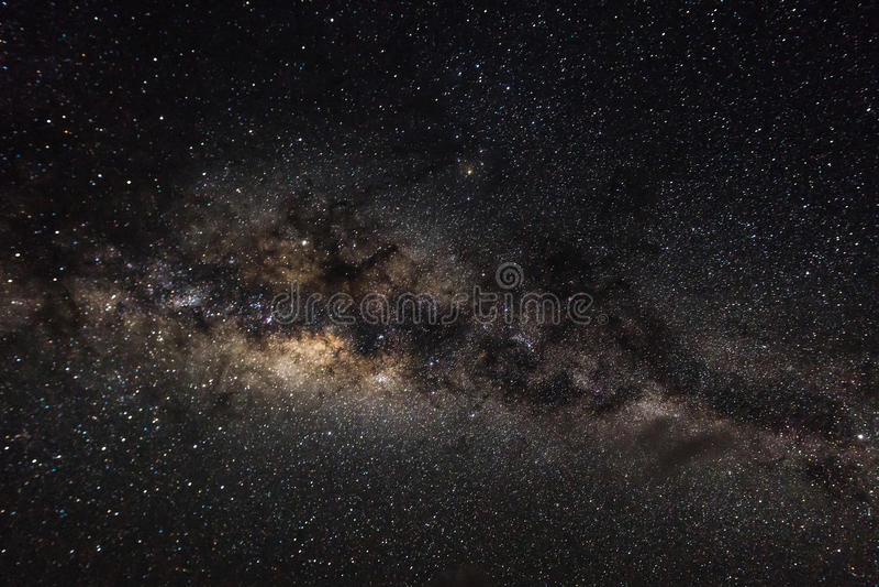 Bakgrund för djupt utrymme med stardust och den glänsande stjärnan Vintergatan royaltyfri fotografi