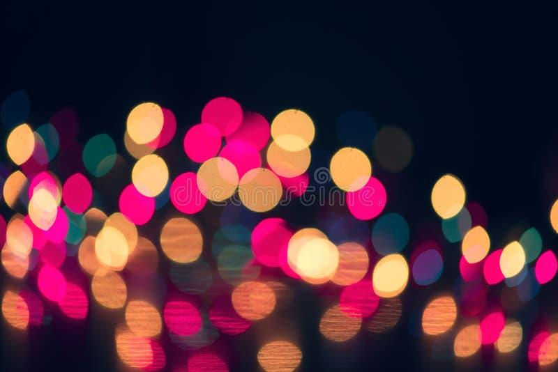 Bakgrund för ferie för julbokeh glödande Glödande abstrakta defocused ljus för ferie arkivfoton
