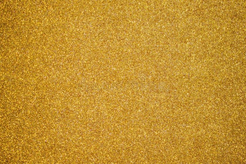 Bakgrund för glitter i guld arkivfoto