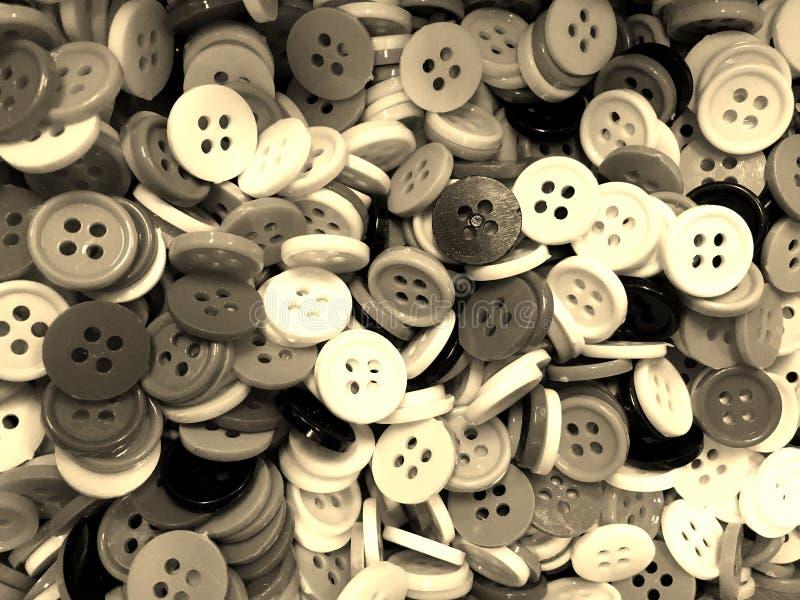 Bakgrund för knappar för Sepiasignal bråkig liten sy arkivfoton