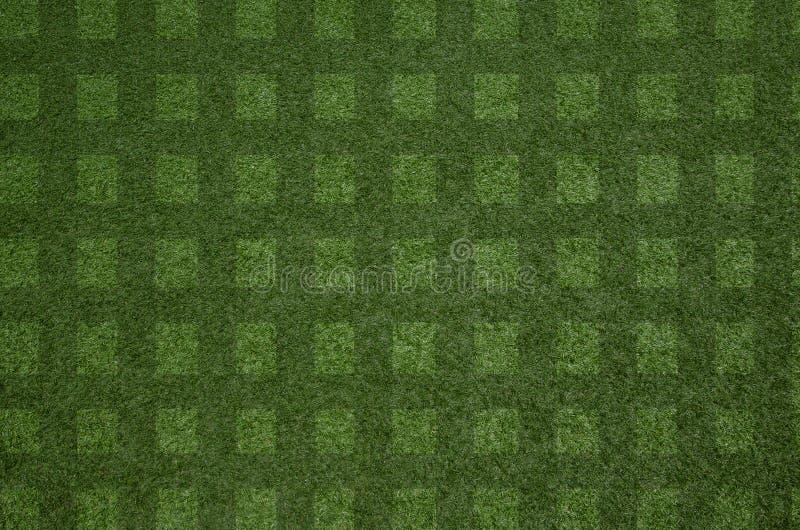 Bakgrund för modell för textur för grönt gräs för Closeup ny för fotbollfält fotografering för bildbyråer