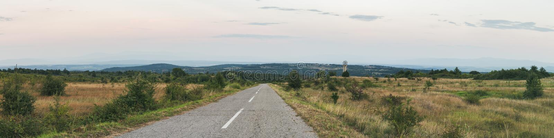 Bakgrund för panorama för landsväg arkivbilder