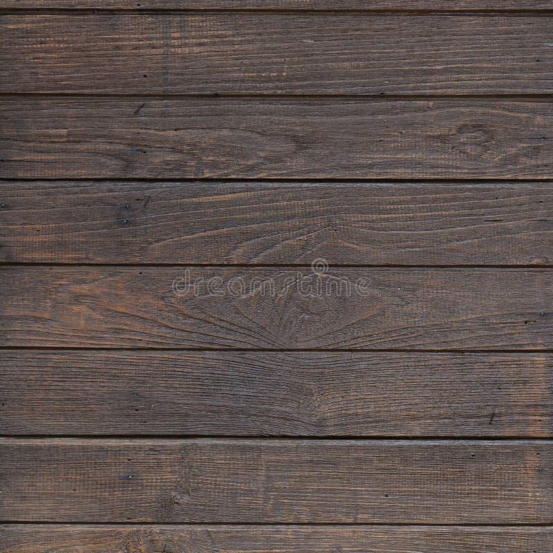 Bakgrund för planka för vägg för timmerträbrunt arkivfoton
