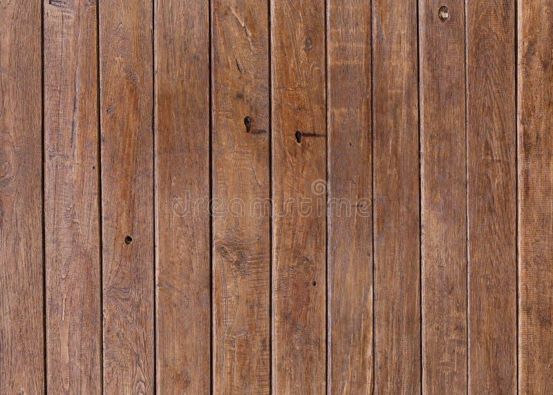 Bakgrund för planka för vägg för timmerträbrunt arkivbilder