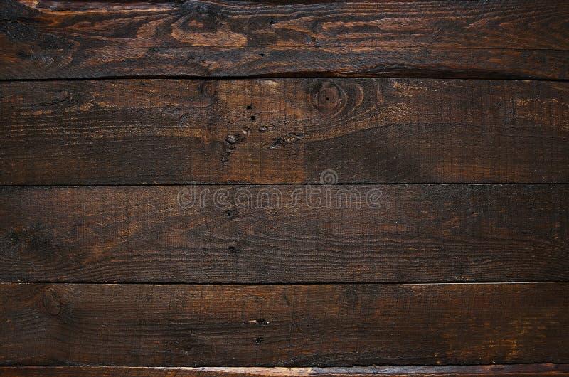Bakgrund för plankor för lantlig åldrig ladugård för mörk brunt wood royaltyfri bild