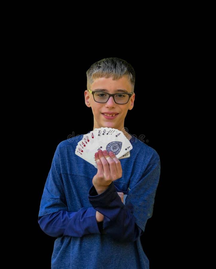 Bakgrund för pojketrollkarlMagic Card Trick svart royaltyfri foto