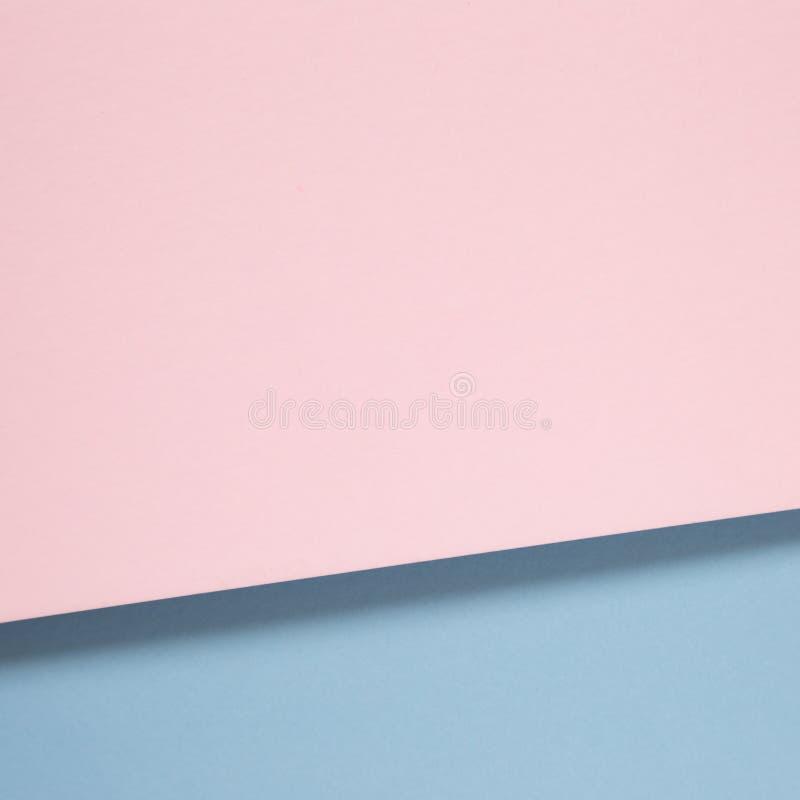 Bakgrund för rosa färg- och blåttfärgpapper arkivbilder