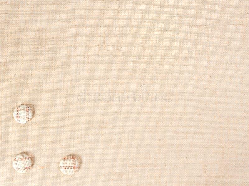 Bakgrund för säckvävtygtextur och knappgarnering, säckvävsäcktorkduk arkivbild