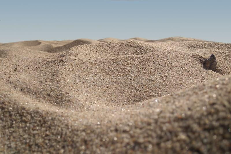 Bakgrund för strand sand Makro arkivbilder