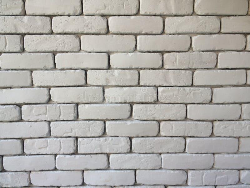 Bakgrund för tegelstenkvartervägg i vardagsrum hemma, vit vägg i hus, restaurang eller kafé, vit stor tapet för tegelstenkvarterv royaltyfria bilder
