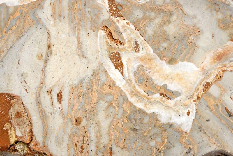 Bakgrund för textur för apelsinbruntmarmor arkivfoton