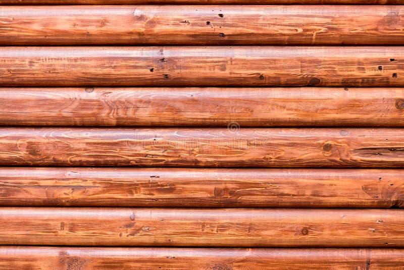 Bakgrund för textur för planka för glasyrbruntjournaler wood royaltyfri bild