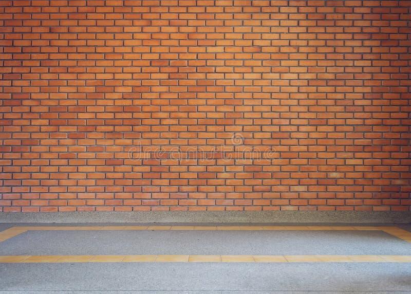 Bakgrund för textur för tegelstenvägg och liten grussten royaltyfri bild