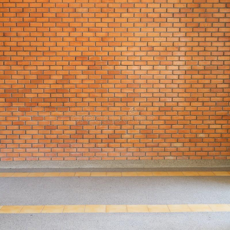 Bakgrund för textur för tegelstenvägg och liten grussten fotografering för bildbyråer