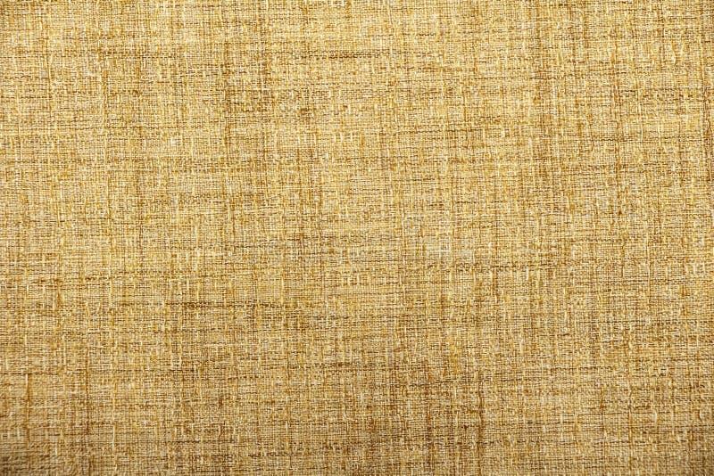 Bakgrund för textur för hessianssäckväv säckväv vävd/bakgrund för vävt tyg för bomull med fläckar av varierande färger av beiga o arkivfoto