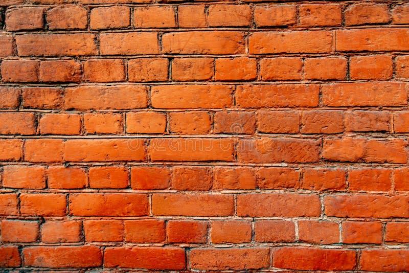 Bakgrund för textur för vind för tegelstenvägg orange royaltyfria bilder