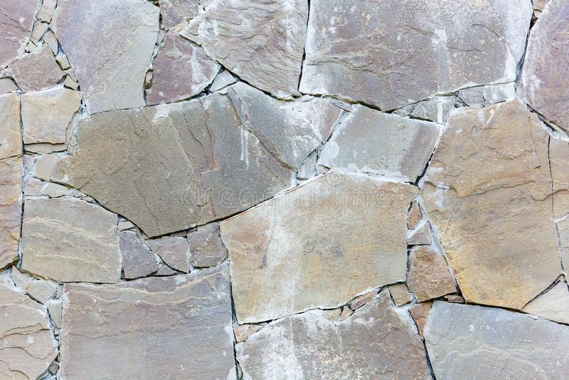 Bakgrund för vägg för Craked grå färger betong texturerad arkivbild