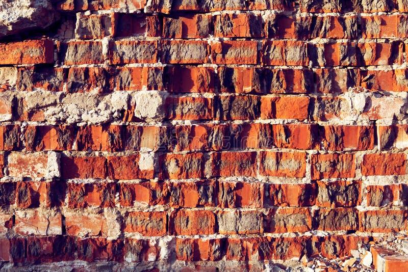 Bakgrund för vägg Craked för röd tegelsten för desygn fotografering för bildbyråer
