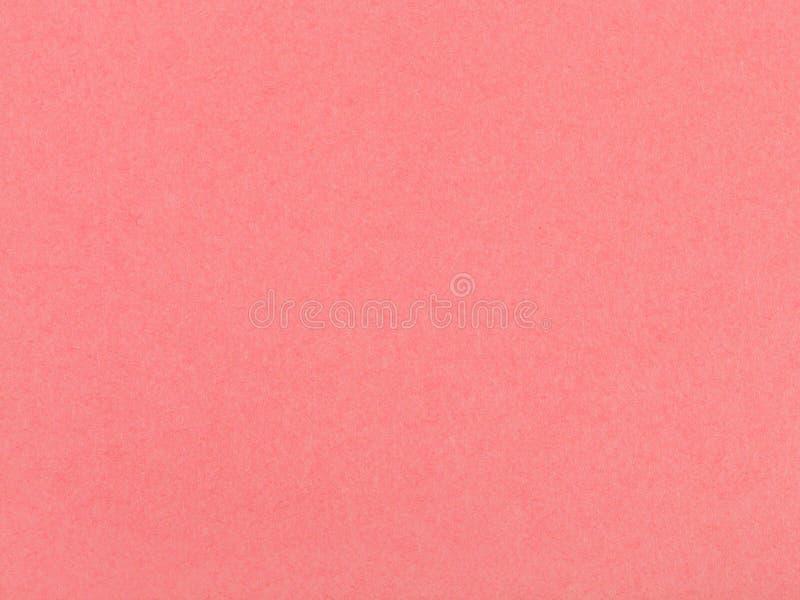 Bakgrund från arket av korall färgade pastellpapper royaltyfri foto