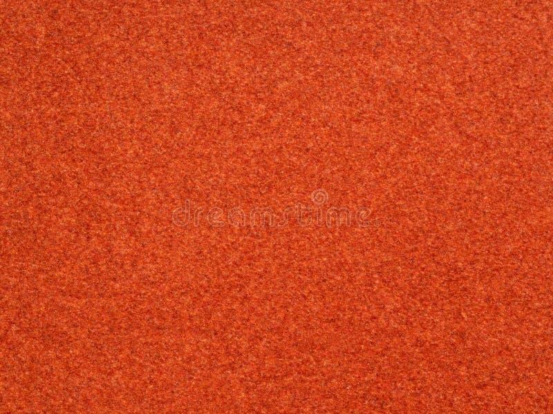 bakgrund från brunt orange sammetflockpapper arkivbild