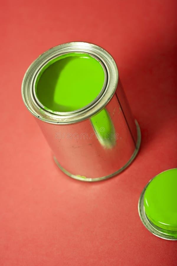 bakgrund kan green målarfärgred arkivfoton