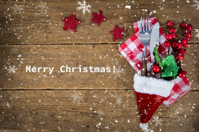bakgrund med bestick i santa&en x27; s-hatt arkivbilder
